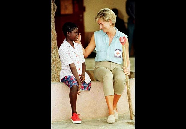Princess Diana visits a young girl at an orthopedic workshop in Angola, January 1997. (Ian Jones/Zuma Press/Newscom)