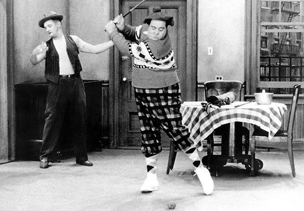 Art Carney teaching golf to Jackie Gleason The Honeymooners