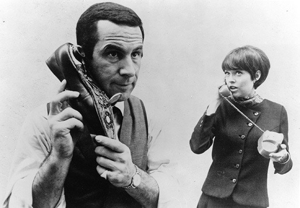 Don Adams listening to shoe phone while Barbara Feldon listens to real phone