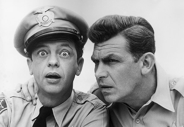 Don Knotts sitting next to Andy Griffith