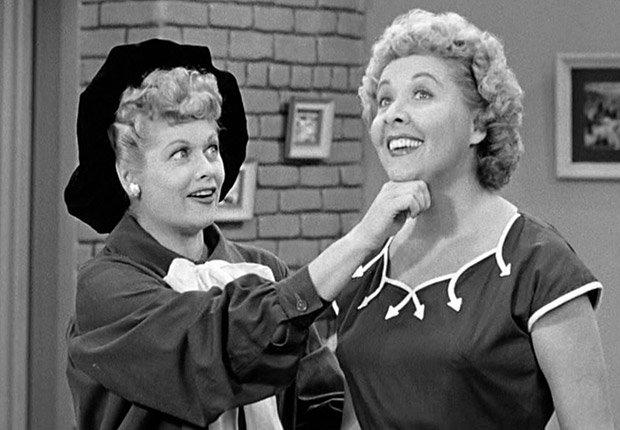 Lucille Ball lifting Vivian Vance's chin