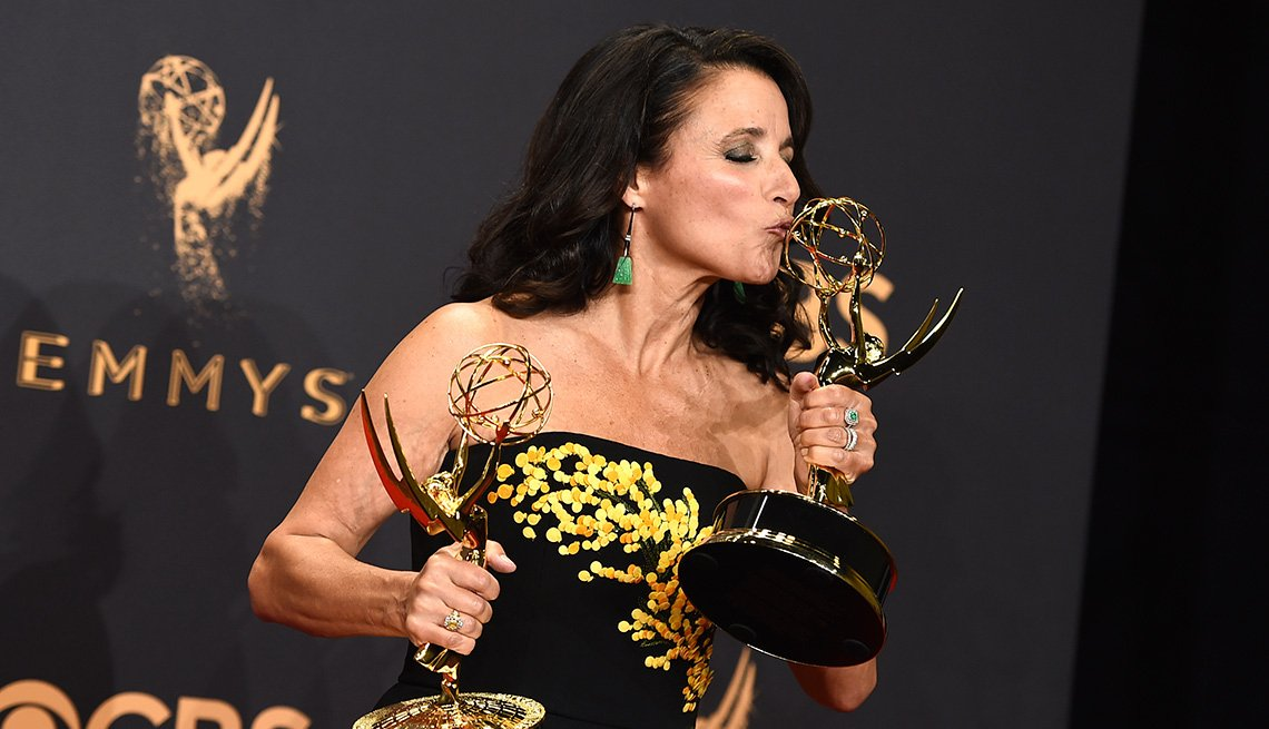 Julia Louis-Dreyfus holds her Emmy's for outstanding lead actress in a comedy series and outstanding comedy series