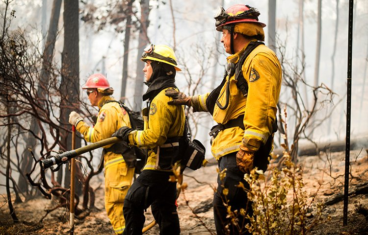 firefighter with the Fremont Fire Department, battles the Loma wildfire near Morgan Hill, Calif.