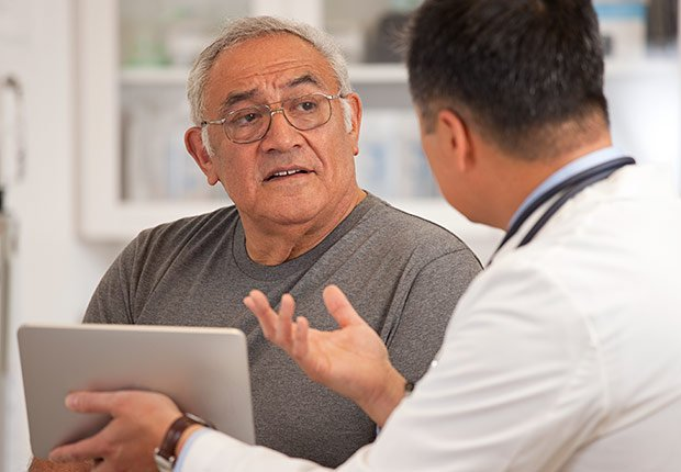 Doctor talking to man, How to Get the Right Hearing Aid: 10 Tips