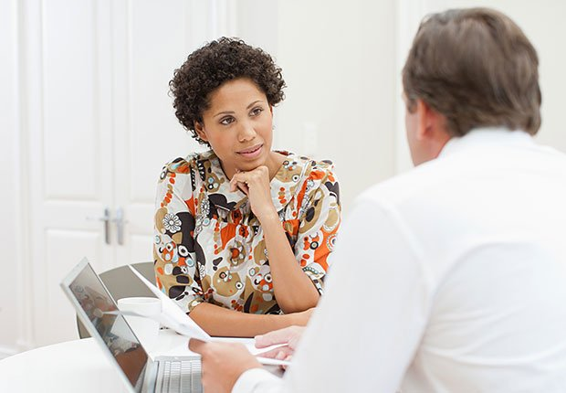 Woman meeting with man to negotiate price, How to Get the Right Hearing Aid: 10 Tips