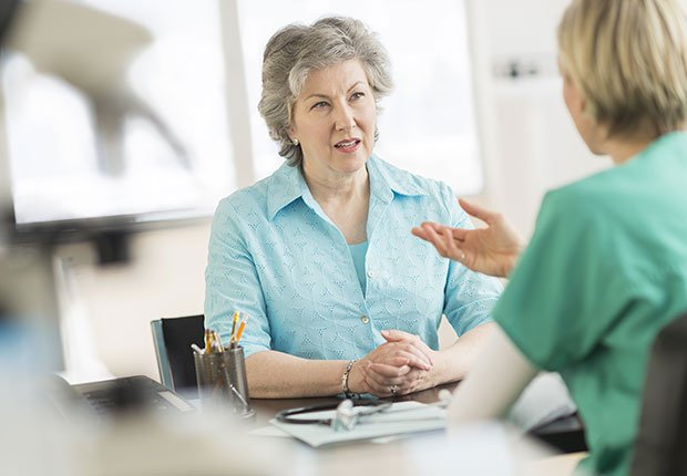 Doctor talking priorities to patient in office, How to Get the Right Hearing Aid: 10 Tips