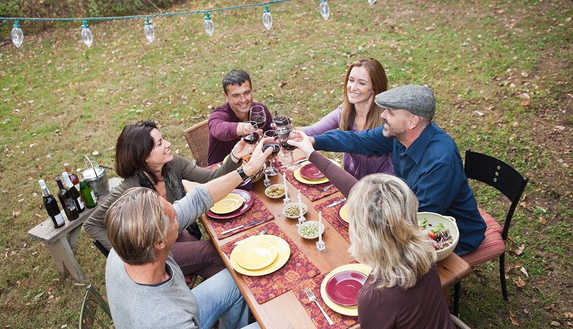 Friends toast outdoor dinner party, Diabetes prevention