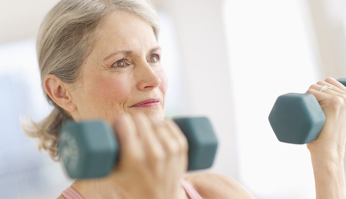 Woman exercise dumbbells, diabetes prevention