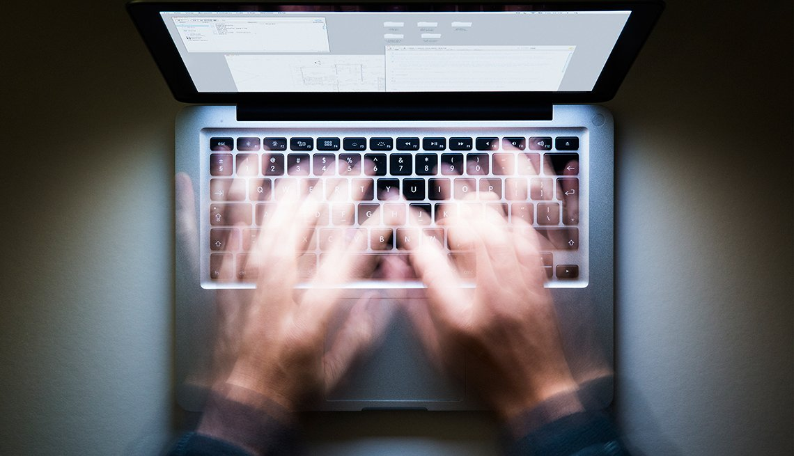 Hands in motion blurred over a laptop keyboard, Workplace Hearing Loss coping strategies