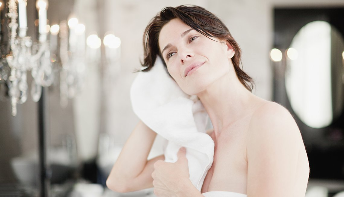 A woman dries her ears, Tips to Protect Your Hearing