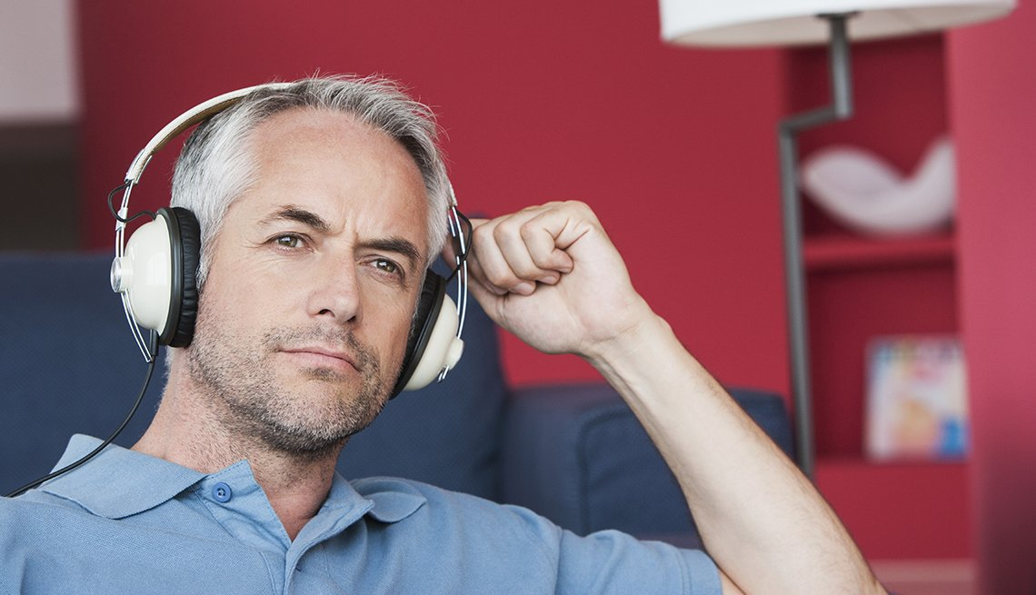 Man listening to headphones, Tips to Protect Your Hearing