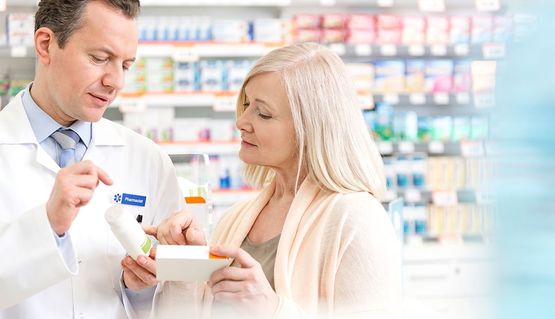 Pharmacist discussing prescription with customer in pharmacy