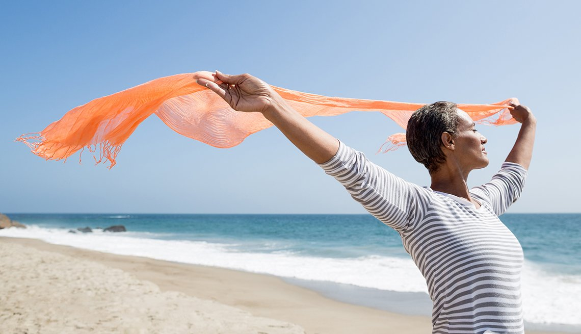 Picture of an african american senior woman enjoying the beach in California