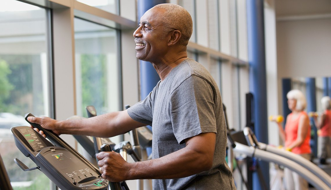 African-American man, elliptical machine, gym, Personal Best: My Fitness