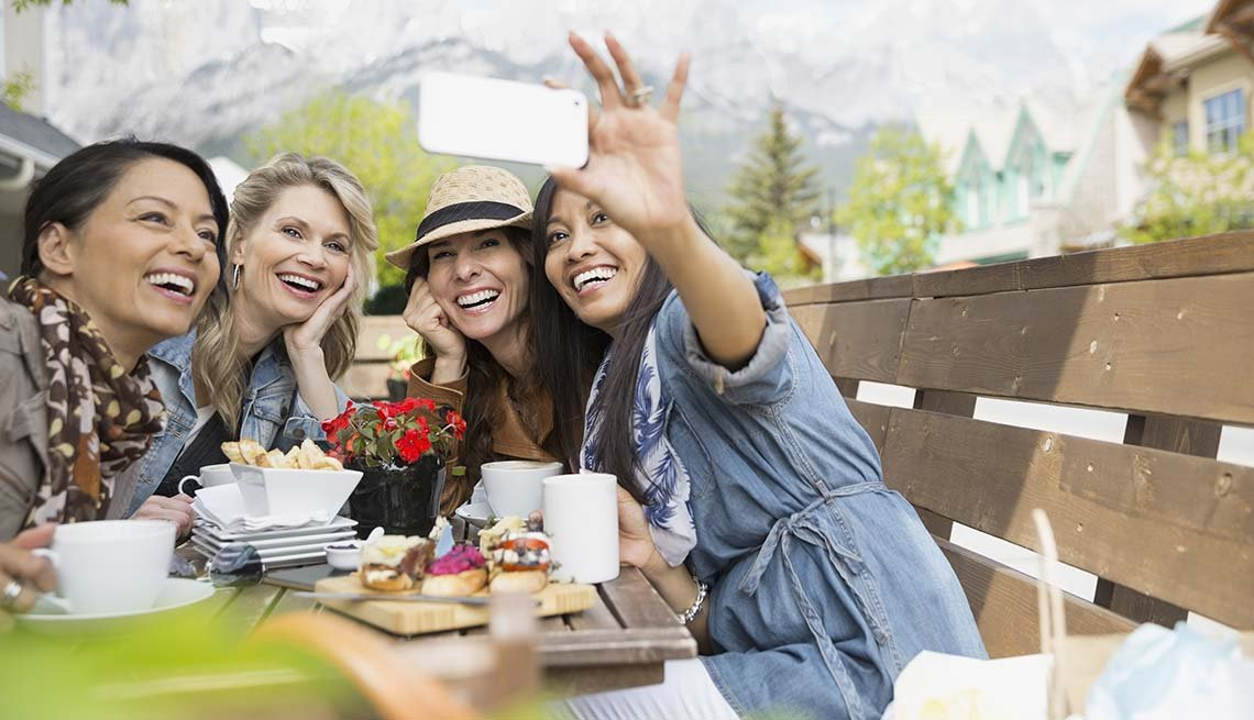Women take a group selfie, Reduce Stress with friends