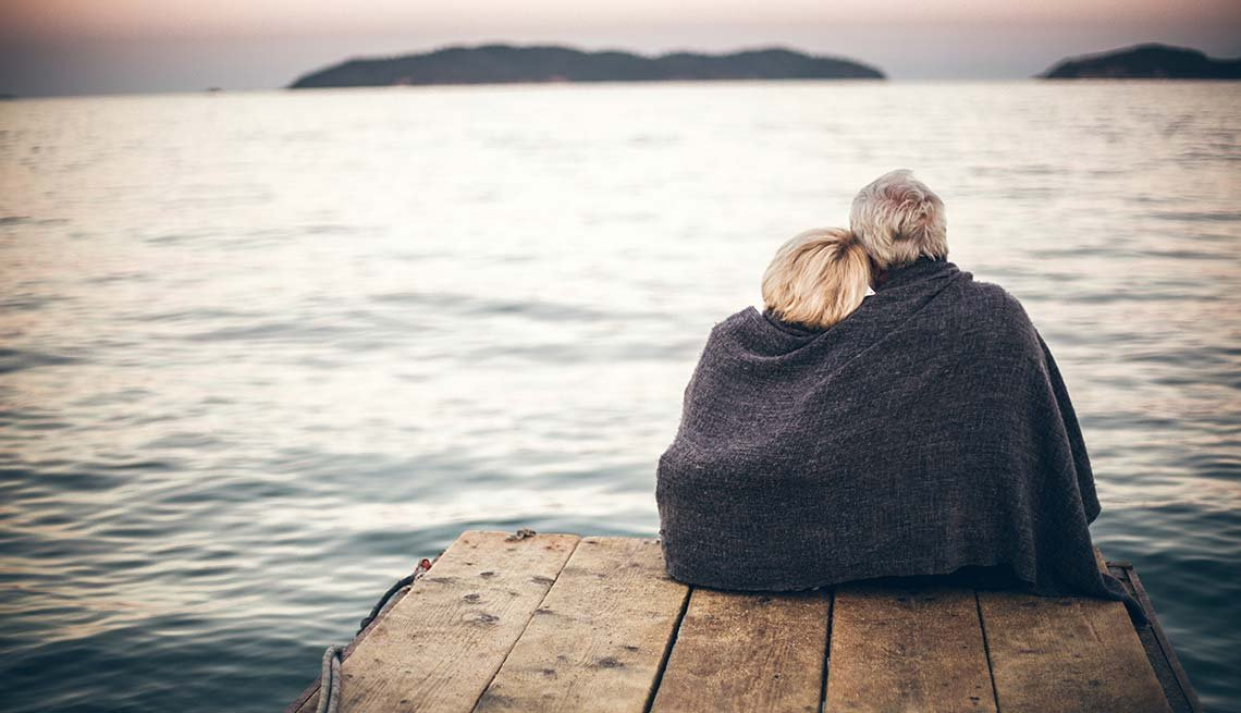 Couple in blanket on a dock, Intimacy Reduces Stress