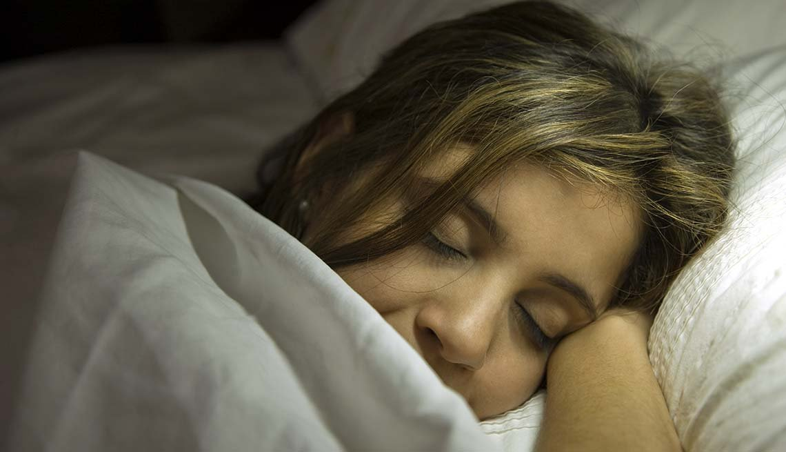 Woman sleeps in bed, Sleep Reduces Stress
