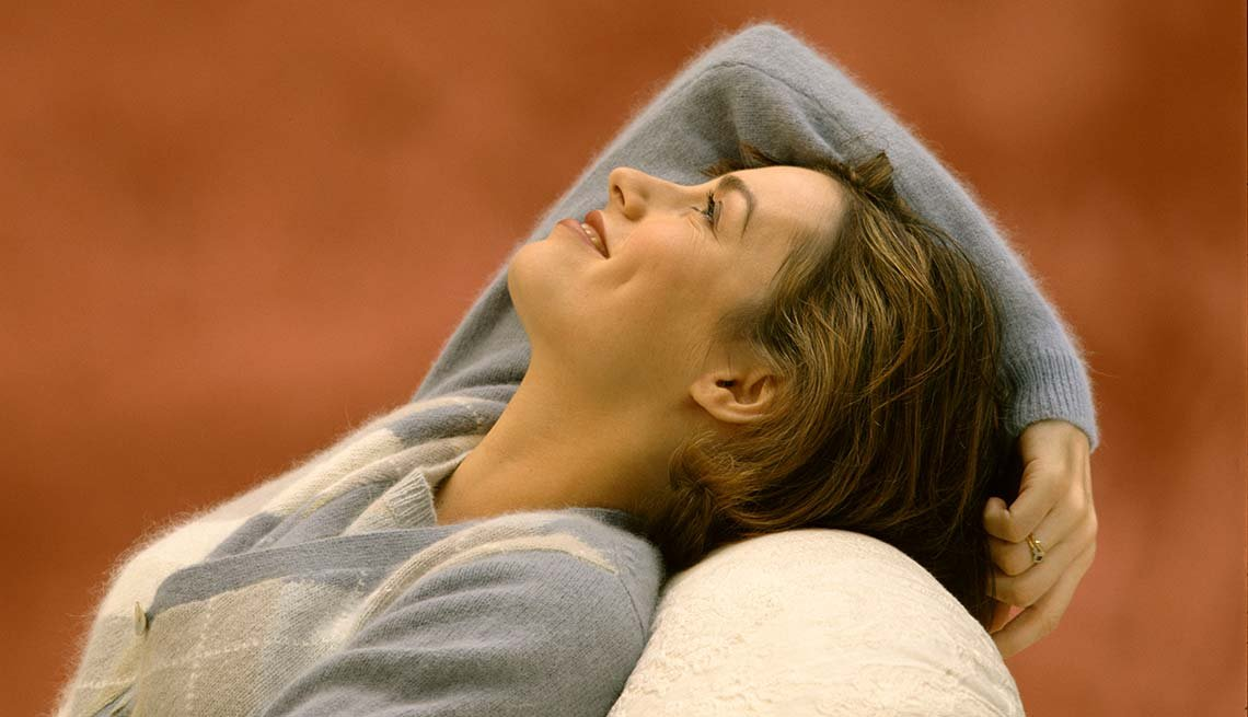 Woman relaxes in chair, Reduce Stress Relax Rest