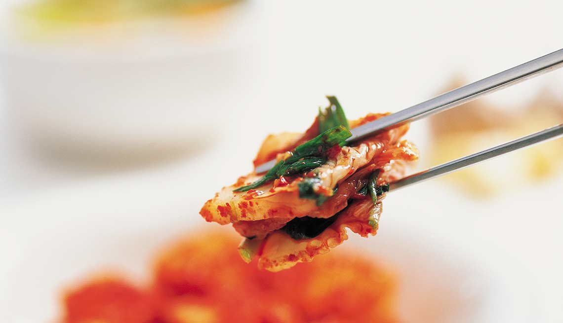 Kimchi on chopsticks, Foods That Help Your Gut