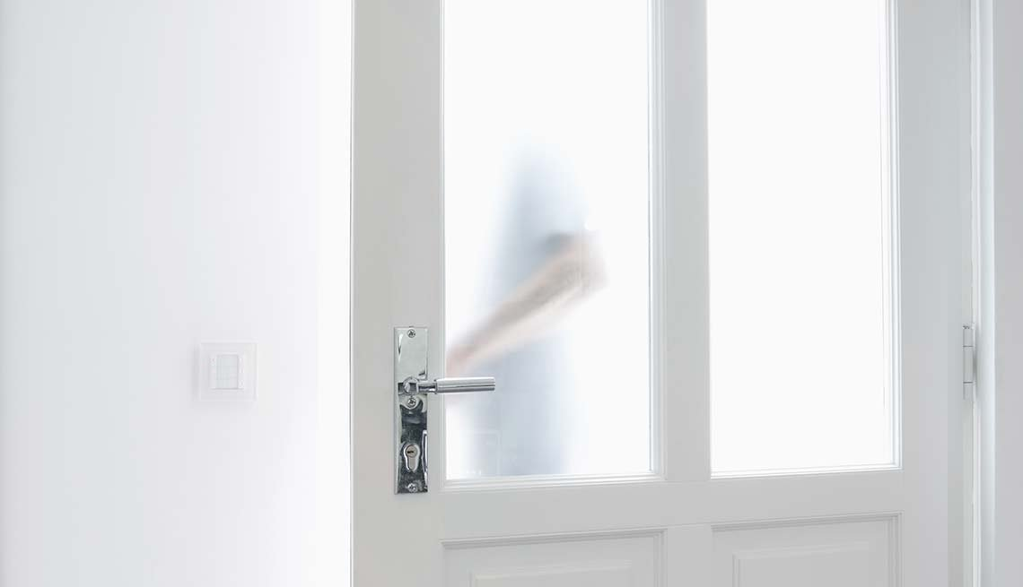 Person opening a door with glass panels, Smartphone Health Apps Can Save Your Life