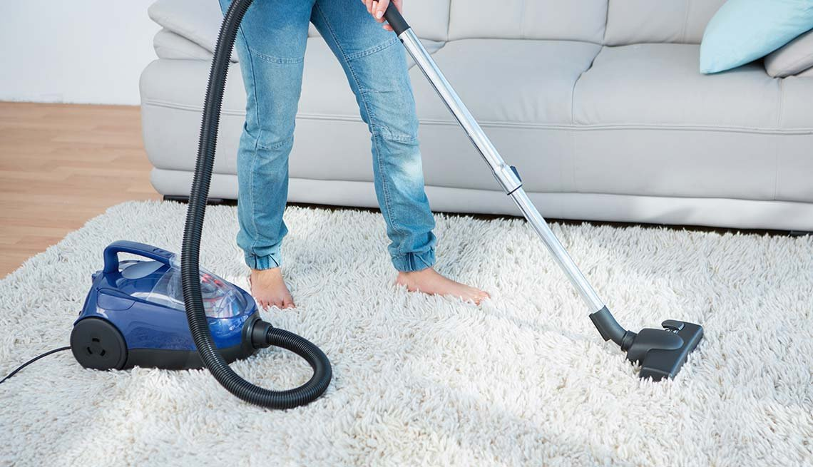Woman vacuums white rug, Cheap Creative Workout, Home Exercise