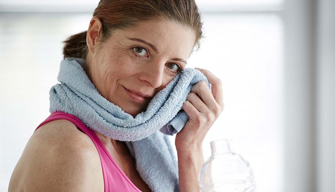 Woman wipes face at home, Excercise, Cheap Creative Workout, Home Exercise
