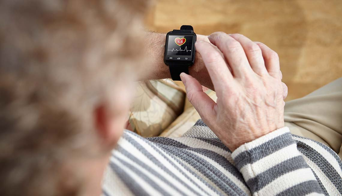 Man checks smart watch fitness, Cheap Creative Workout, Home Exercise