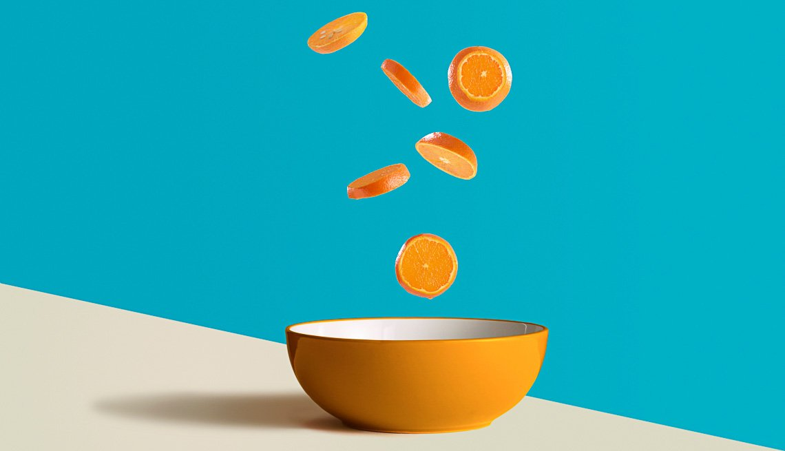 Sliced Oranges over a bowl, Eye Healthy Foods