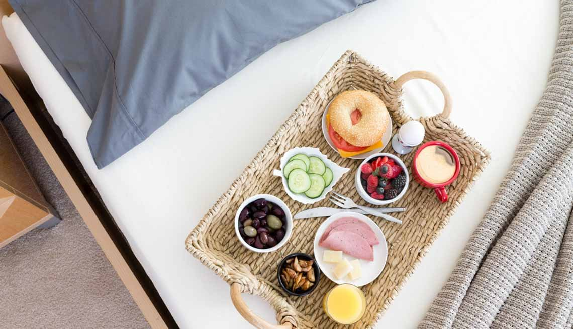 Breakfast Tray on Unmade Bed, Stay Healthy on Vacation