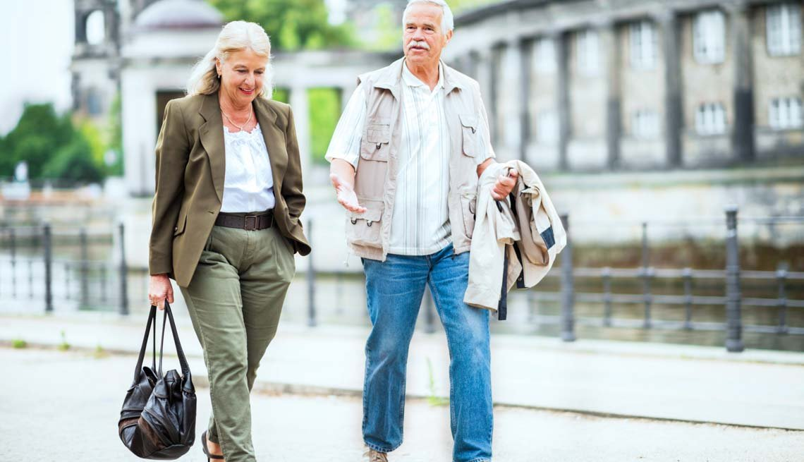 Couple walk on an old street, Stay Healthy on Vacation