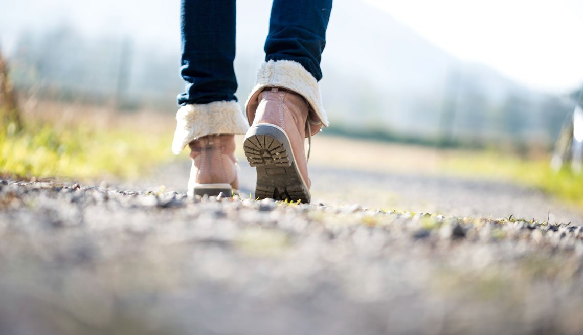 Woman walking along a rural path, 7 Ways to Make Your Morning Healthier