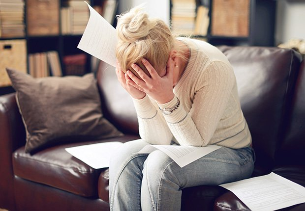 Woman-Sitting-Stressed-Foods-That-Reduce-Stress