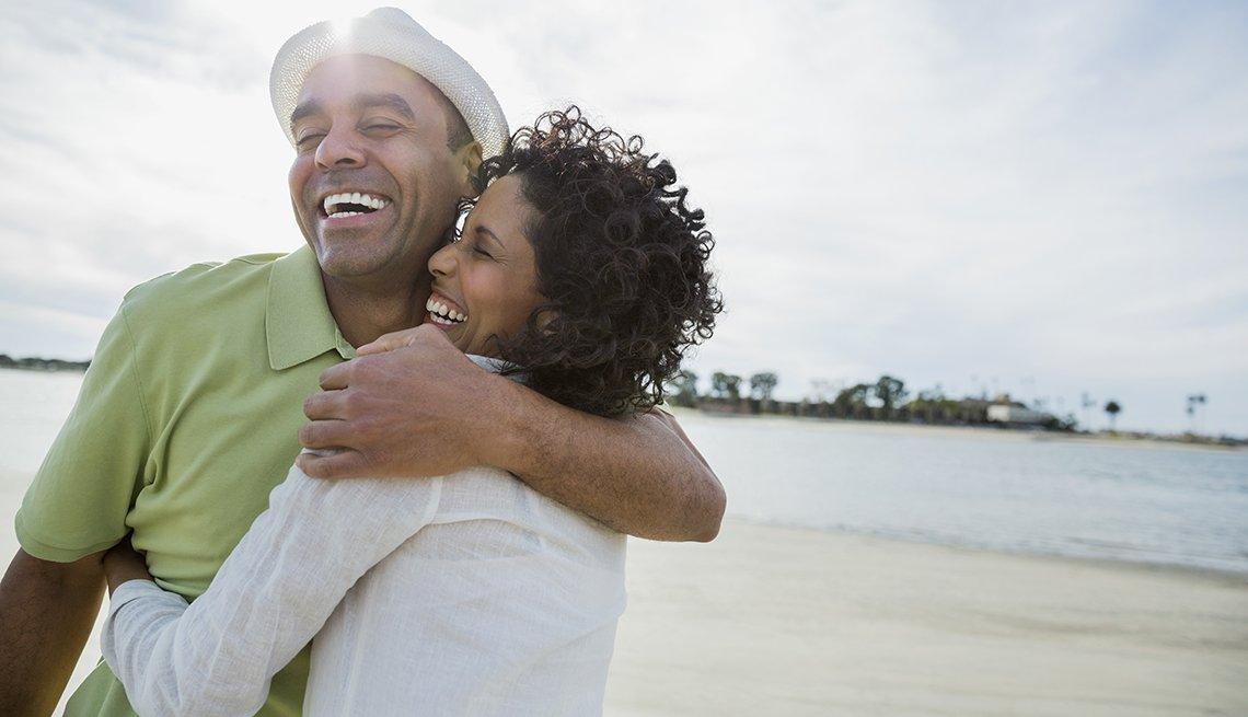 Mature adult couple hugging