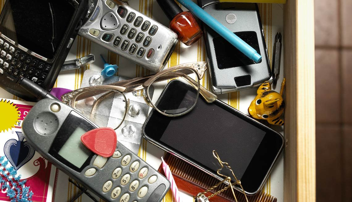 Old cellphones, remotes and things in a junk drawer, Things to Throw Out