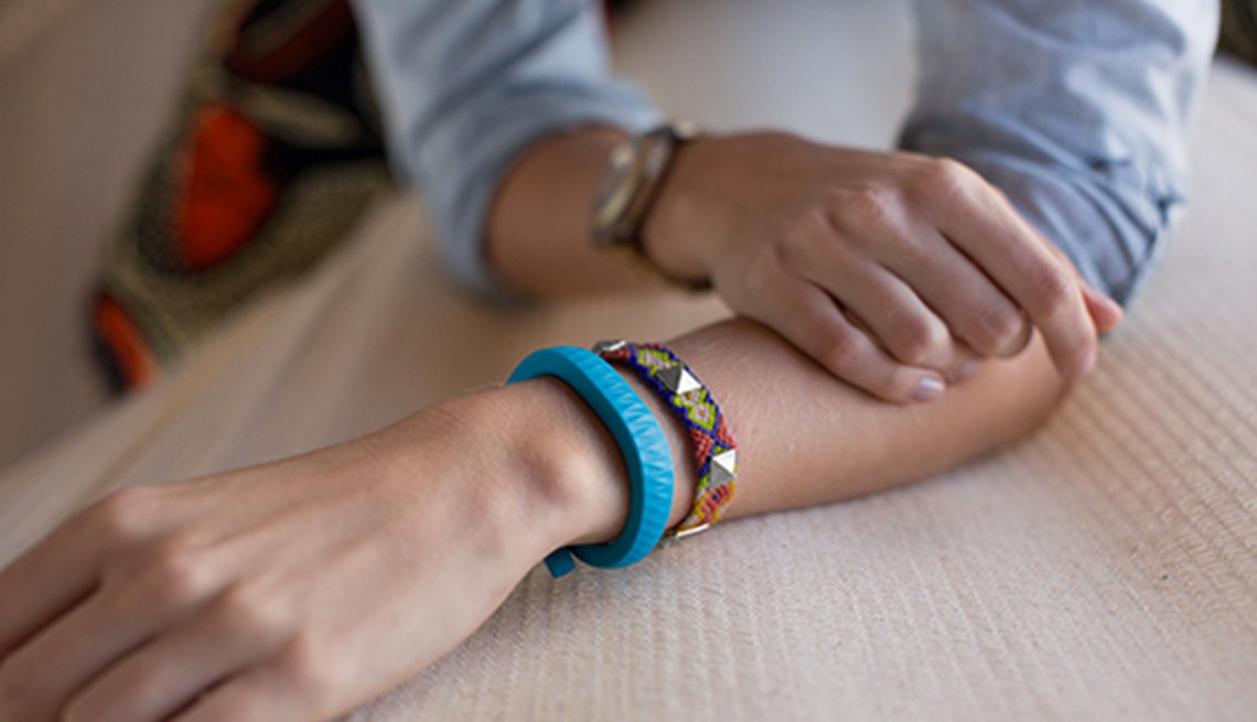 Fitness trackers, Woman wears bracelets, Healthy Holiday Gifts