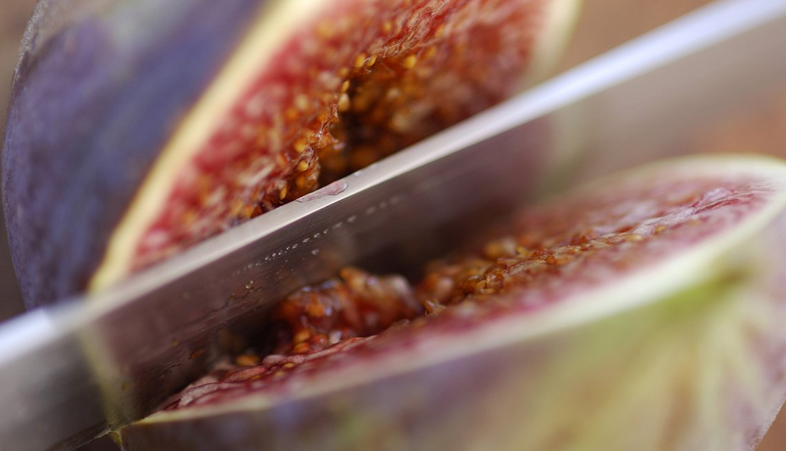 Knife slicing a fig, Fat Busting Fall Foods