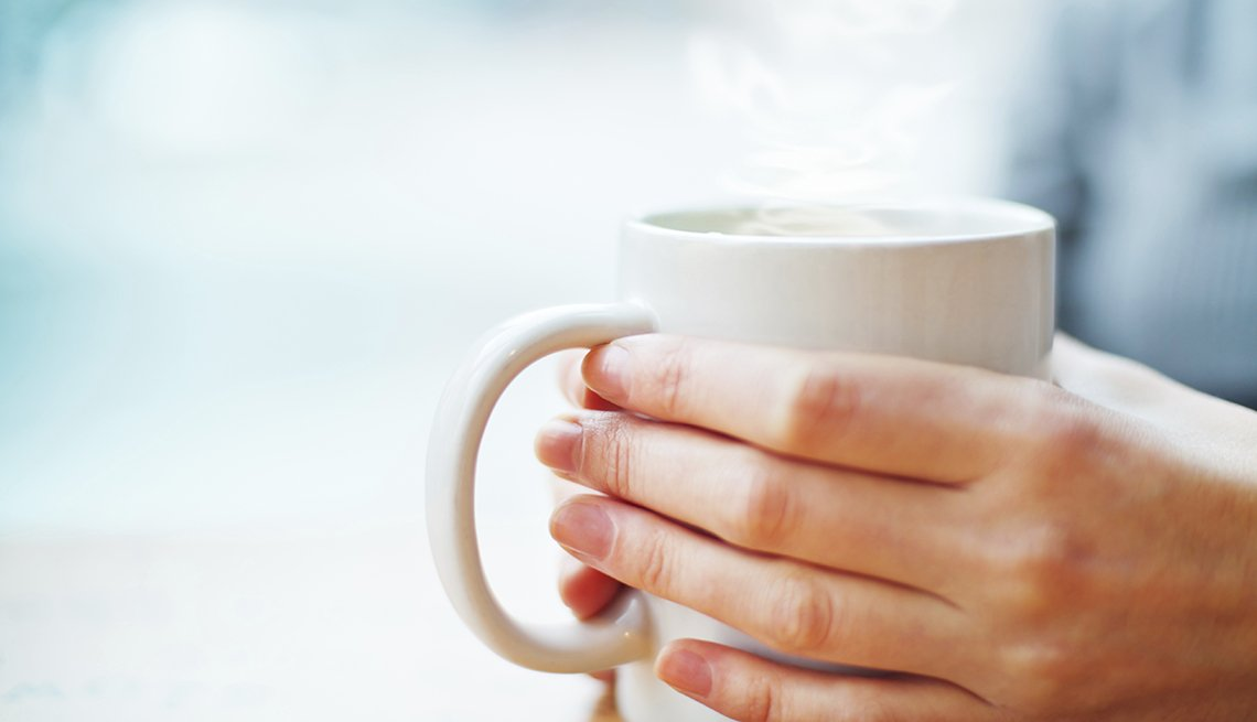 Woman's hands hold white cup of hot beverage, Skipping Breakfast, Habits That Are Good For You