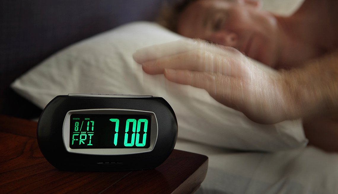 Man reaches for Alarm clock, Nine Numbers Extend Life, 7 Hours Sleep Needed