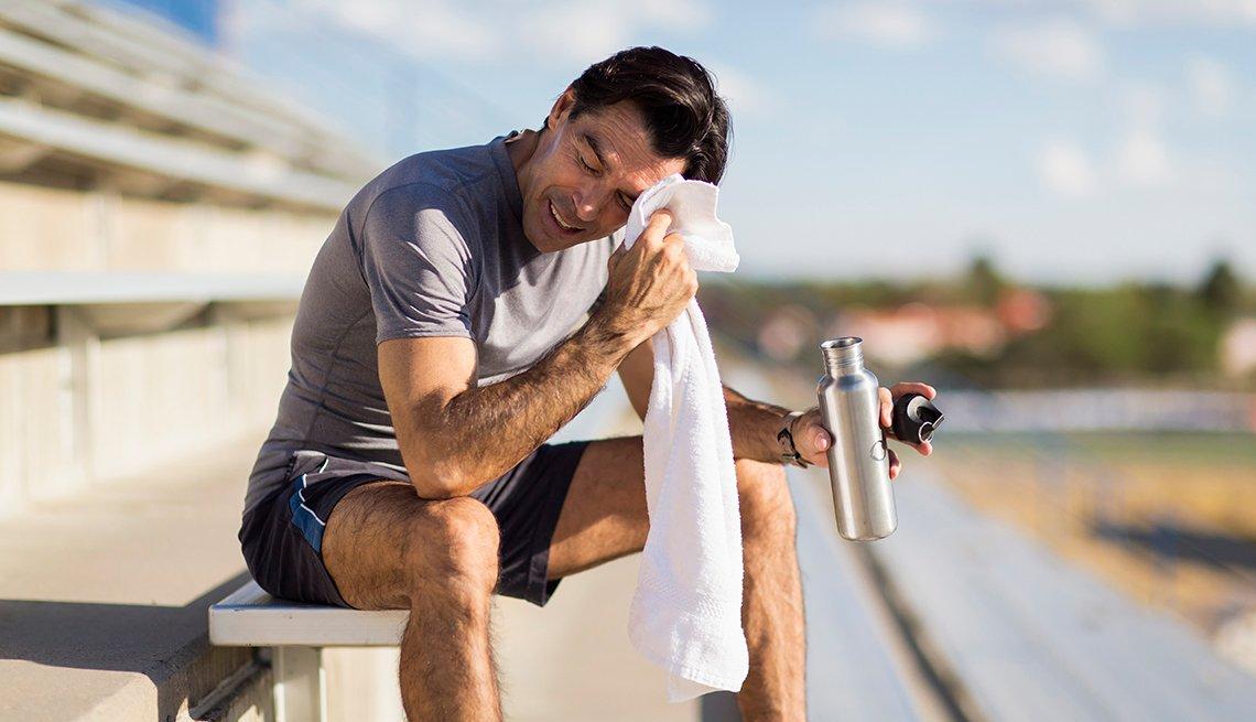 Man wipes his face on bleacher, Santa Fe, Mini workouts work