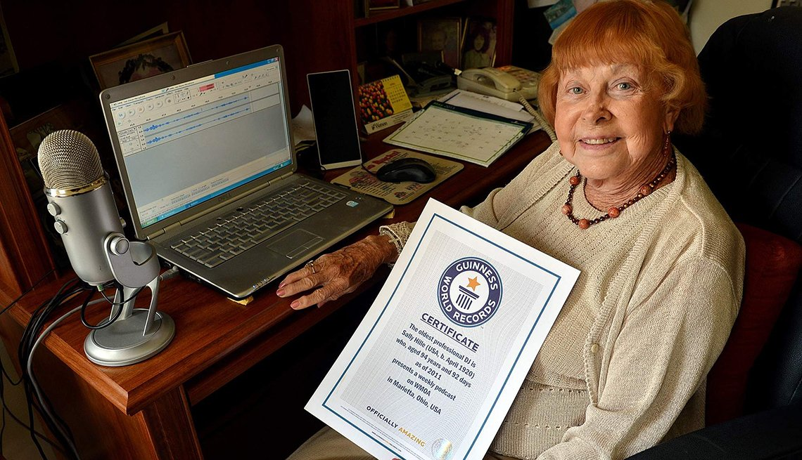 Sally Hille holding her certificate