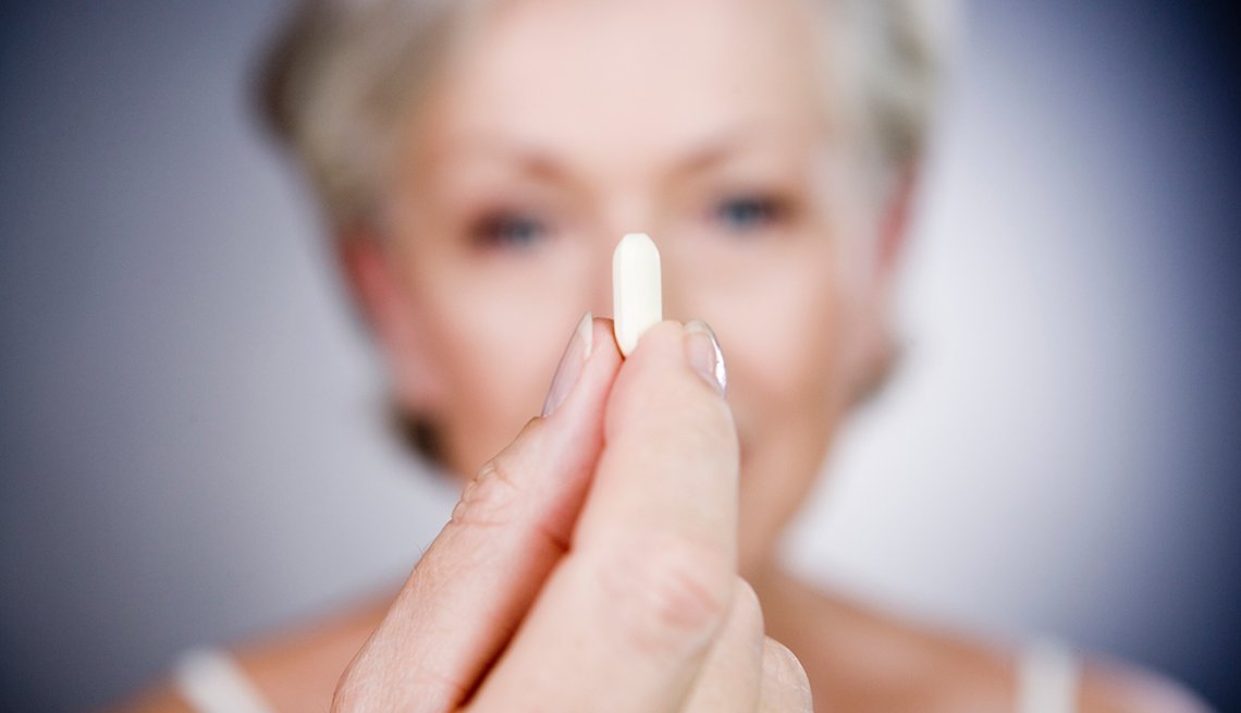 Woman displays a pill, Good Habits Go Bad