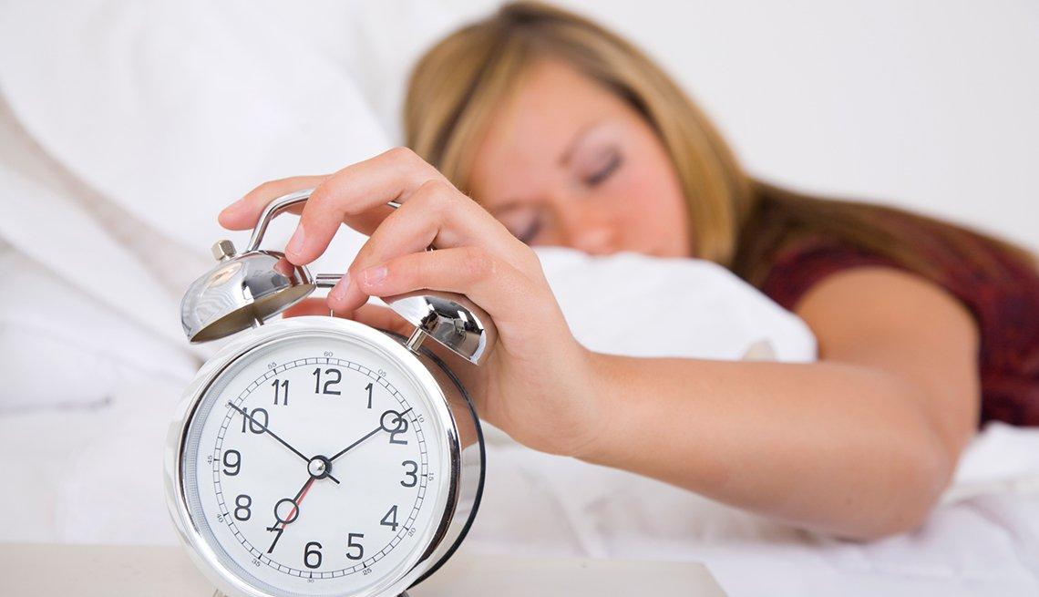 Woman sleeps by alarm clock, Good Habits Go Bad