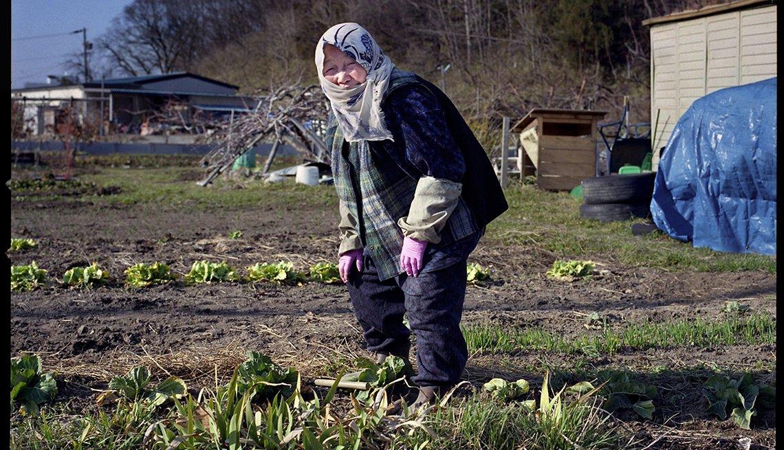 Mrs. Hanegi, weeding garden plot, Longest Living place on Earth