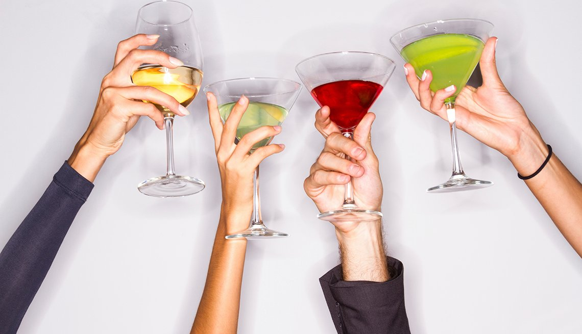 Women raise cocktail glasses, arms and drinks, How Not to Gain Those 10 Holiday Pounds