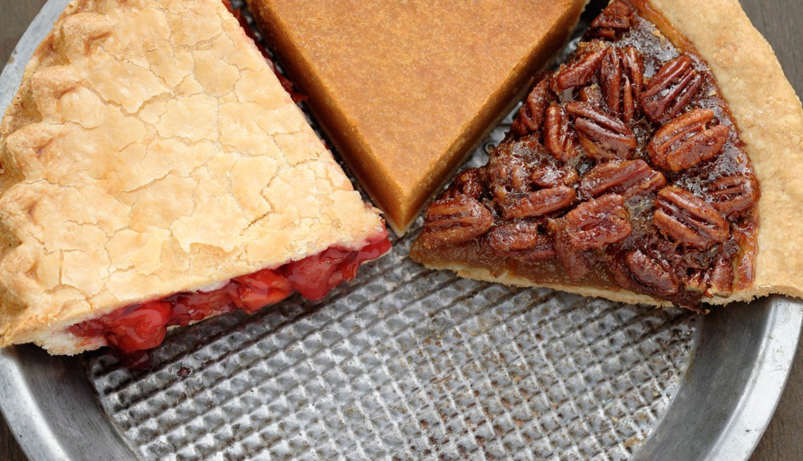 Slices of pie in a pan, pecan, cherry and pumpkin pie slices, How Not to Gain Those 10 Holiday Pounds