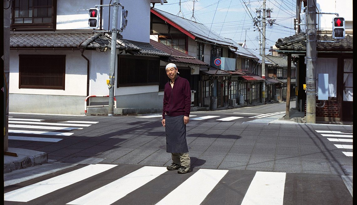 Sake shop owner, man in empty intersection, Nagano, Japan, Longest Living place on Earth