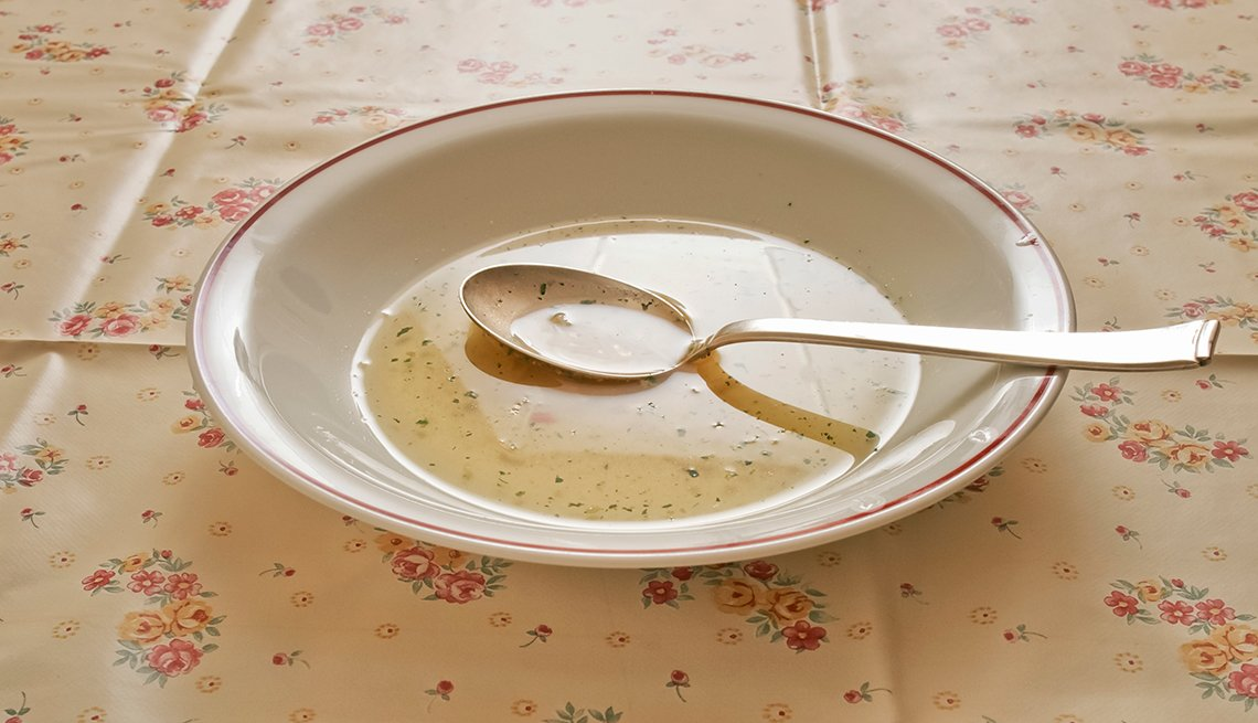 A bowl of clear soup on tablecloth, How Not to Gain Those 10 Holiday Pounds