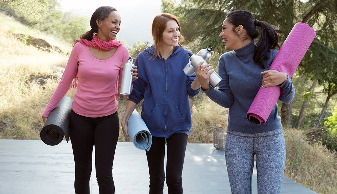 Women chat before the start of yoga class, yoga gear you need