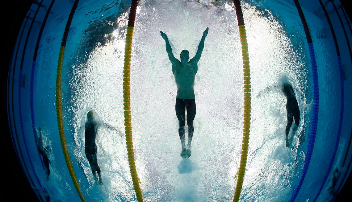 Swimmers From Underwater, Michael Phelps Butterfly Stroke, How to Quadruple Your Energy