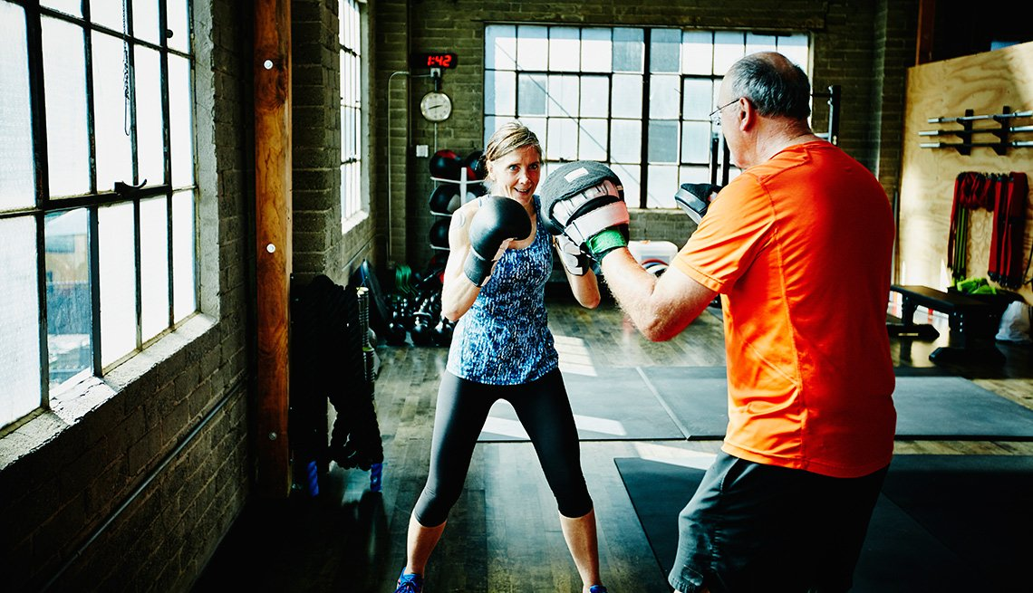 woman and man boxing in a gym